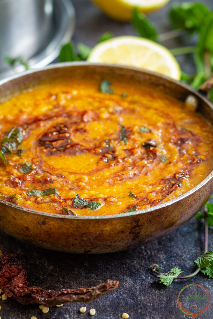 Yellow moong dal tadka fry with tempering & garnished with some chopped cilantro